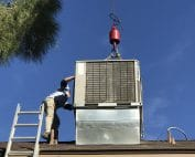 Patriot Air's men installing a new hvac unit