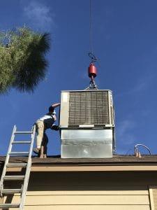 Patriot Air's men installing a new hvac unit